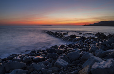 Kimmeridge Bay with wet rocks and sunset