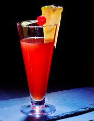 Red  drink  with cherry and pineapple  23.