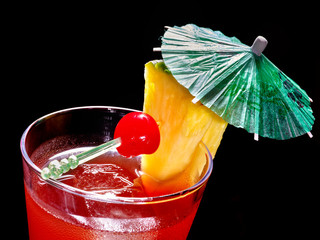 Pineapple red  cocktail with cherry and umbrella