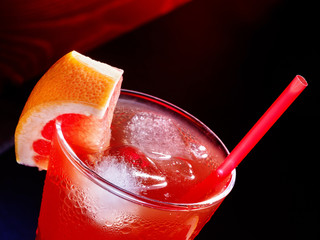 Red drink  with grapefruit and cube ice