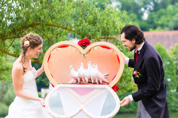 Wedding bride and groom with white doves