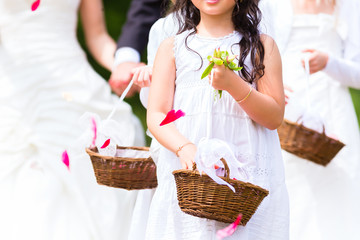 Wedding bridesmaids with flower petal basket