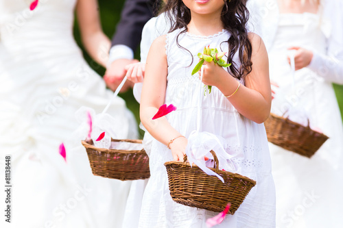 Wedding bridesmaids with flower petal basket