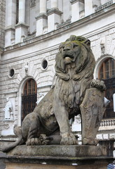 Lion statue with shield in Vienna Hofburg, Austria