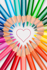 Colored pencils lined up in heart frame