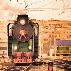 Retro steam train at sunset.