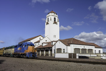 Train depot and engine passing by