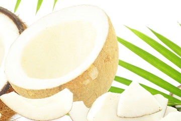 coconut peeled with leaves in pure white background
