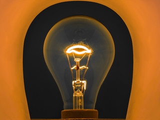 glowing light bulb by electrical current