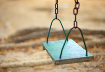 empty wood swing in the park