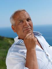 senior man sitting outside