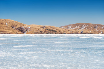 Beautiful landscape with ice and snow on the lake