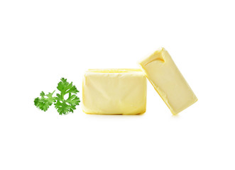 parsley and Stick of butter isolated on white.
