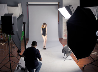 The photographer photographs the professional model