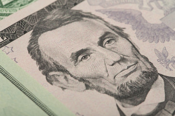 Macro of Abraham Lincoln on five USA dollar banknote