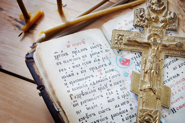 Christian still life with ancient book and old metal cross