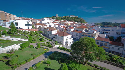 Castle with houses with red roof near the city Sesimbra