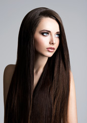 Portrait of beautiful woman with long straight brown hair