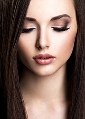 Face of beautiful young woman with brown make-up and  straight