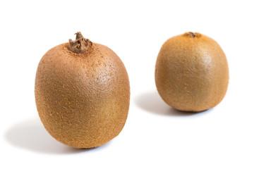 Closeup of two kiwifruits isolated on white background
