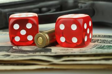 dice, gun and money