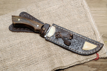 Beautifully decorated with a hunting knife and  case for a knife