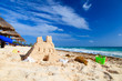 Sand castle with shells built on the beach