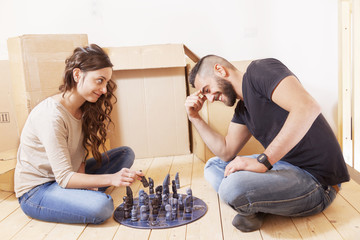 young couple playing chess after the move