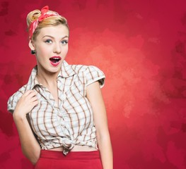 Retro. Pin-up style portrait of surprised blonde woman sepia