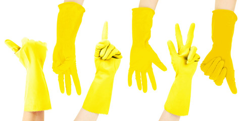 Hands in yellow gloves gesturing numbers isolated on white