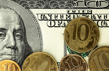 Russian rubles coins and dollars banknotes close up