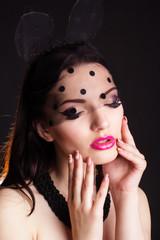 Portrait of woman in bunny lace ears mask