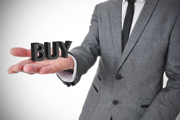 businessman with the word buy in his hand