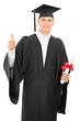 College graduate giving a thumb up