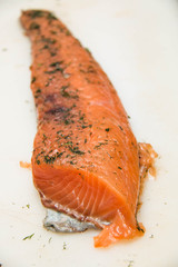 Salmon fillet slices with fresh herbs.