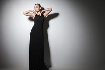 beautiful woman model posing in elegant black dress