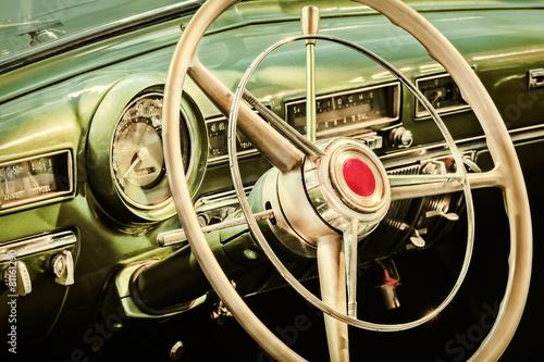 Zdjęcia na płótnie, fototapety na wymiar, obrazy na ścianę : Retro styled image of the interior of a classic car