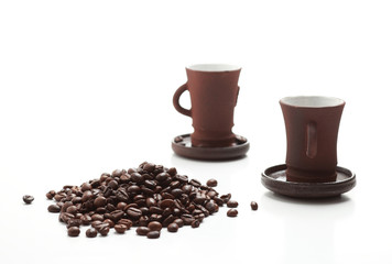 Two cups of coffee with coffee beans isolated on white backgroun