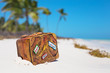 Travel suitcase toy on the beach - 81162463
