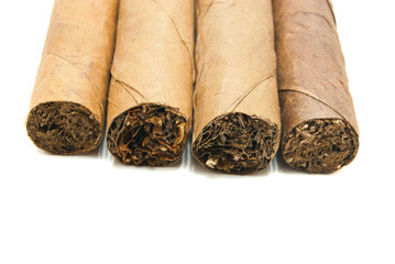 several Cuban cigars on white