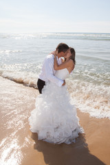 wedding couple background, kissing at the Ocean