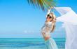 Beautiful woman enjoying vacation in tropical destination