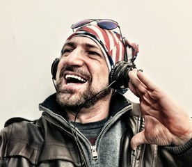 happy man listening to the music with a usa flag bandana