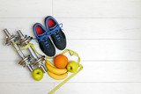 fitness equipment and fruits on white wooden plank floor poster
