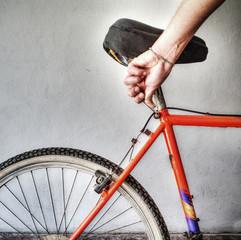 man repairing a mountain bike in a workshop in hdr