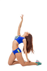 Artistic young sportswoman exercising at camera