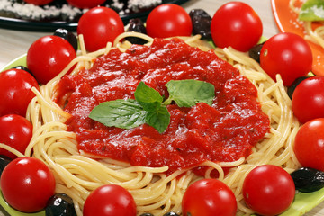 spaghetti with tomatoes olives and sauce