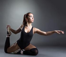 Image of inspired ballerina posing in studio