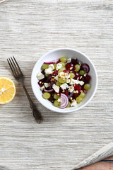 Homemade salad with beet, grapes and onions