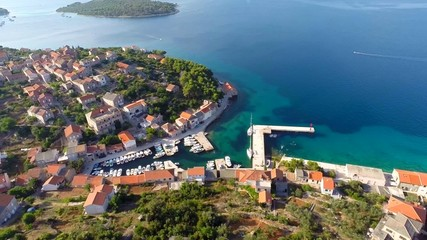 Aerial footage of village and harbour near sea